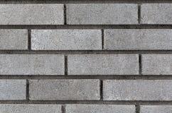 Grijze bakstenen muurachtergrond royalty-vrije stock afbeelding
