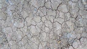 Grijze barst van droge grondachtergrond royalty-vrije stock afbeelding