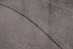 Grijze bruine steentextuur van concrete muur met barst royalty-vrije stock foto