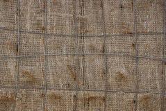 Grijze bruine textuur van oude doek en ijzerdraad stock afbeelding