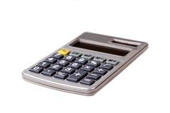 Grijze calculator die op witte achtergrond wordt geïsoleerdm Stock Afbeelding