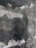 Grijze canvasachtergrond met zwarte verfvlekken Royalty-vrije Stock Foto's