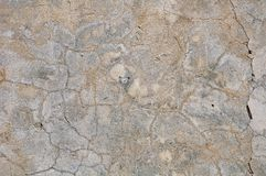 Grijze concrete texturenachtergrond barsten krassen schade stock foto