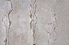 Grijze concrete texturenachtergrond barsten krassen schade stock fotografie