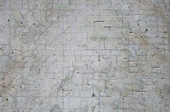 Grijze concrete textuurachtergrond schade De gebarsten achtergrond van de steenmuur stock fotografie