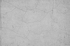Grijze concrete textuurachtergrond schade De gebarsten achtergrond van de steenmuur stock foto's