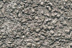 Grijze de textuurachtergrond van de stenenmuur Wegsurfase Royalty-vrije Stock Foto