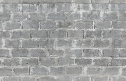 Grijze die muur van concrete blokken wordt gemaakt Naadloze textuur stock afbeelding