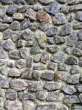 Grijze die muur, van steen wordt gebouwd De textuurachtergrond van de steen Royalty-vrije Stock Fotografie
