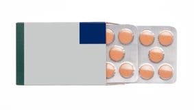 Grijze doos met oranje pillen in een blaarpak Royalty-vrije Stock Foto's