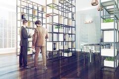 Grijze en witte bureauhoek, installaties, mensen Royalty-vrije Stock Afbeeldingen