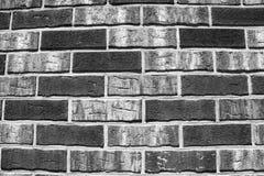 Grijze en zwarte bakstenen muur Stock Foto's