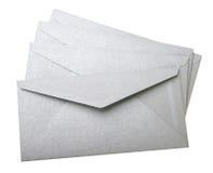 Grijze enveloppen op witte achtergrond Stock Foto