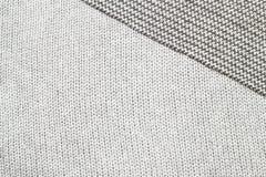 Grijze gebreide die stof van heathered garenachtergrond/textuur wordt gemaakt stock afbeelding