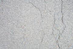 Grijze geteerde vloer met gebreken stock fotografie