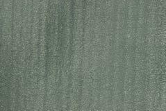Grijze groene textuur van een stuk van plastiek in de muur royalty-vrije stock foto