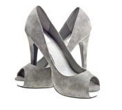 Grijze hoge hielen vrouwelijke laarzen die op wit worden geïsoleerdt royalty-vrije stock afbeelding