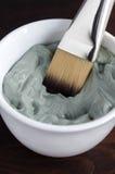 Grijze kosmetische klei royalty-vrije stock afbeeldingen