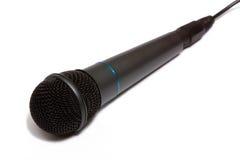 Grijze microfoon die op wit wordt geïsoleerdn. royalty-vrije stock afbeelding
