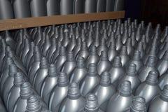 Grijze plastic flessen Stock Afbeeldingen