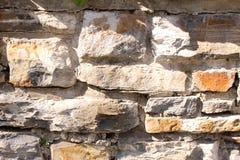 Grijze steenmuur als achtergrond Royalty-vrije Stock Afbeeldingen