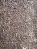 Grijze steentextuur als achtergrond Stock Afbeelding