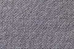Grijze textielclose-up als achtergrond Structuur van de stoffenmacro Royalty-vrije Stock Afbeeldingen