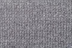Grijze textielclose-up als achtergrond Structuur van de stoffenmacro Stock Afbeelding