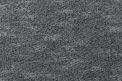 Grijze textielclose-up als achtergrond Structuur van de stoffenmacro Royalty-vrije Stock Foto