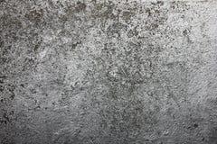 Grijze textuur met gekrast pleister op de muur, royalty-vrije stock afbeeldingen