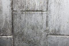 Grijze textuur met gekrast pleister op de muur, royalty-vrije stock fotografie