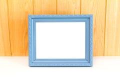 Grijze Uitstekende omlijsting op houten achtergrond Stock Foto