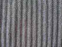 Grijze wol met de hand gebreide textuur abstracte achtergrond Royalty-vrije Stock Afbeelding