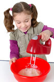 Gril bakinng a cake Royalty Free Stock Photo