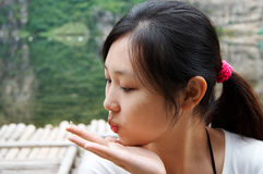 Gril blowing a kiss Stock Images