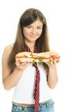 Gril bonito con un sandwitch Fotografía de archivo