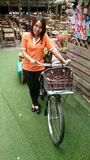 gril cute orange bycicle floor green Stock Photos