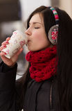 Gril drinking coffee in iwinter Stock Photos