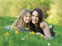 Gril and her mommy Stock Photography