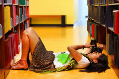 Gril lay down on the floor try to shot the picture Royalty Free Stock Photos