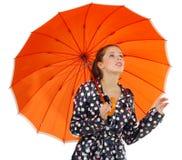 Gril mit orange Regenschirm Lizenzfreies Stockbild