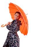 Gril mit orange Regenschirm Lizenzfreie Stockfotografie