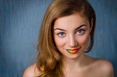 Gril with rainbow lips. Beautiful girl with rainbow lips. Studio shot Royalty Free Stock Photo