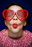 Gril with shutter shades. Young girl with heart shaped shutter shades Royalty Free Stock Photography