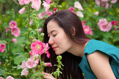 Gril smell the flower Stock Photo