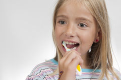 Gril with toothbrush Stock Images