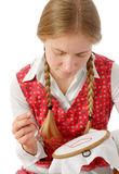 Gril With Plaits Embroidering Red Heart Royalty Free Stock Photo