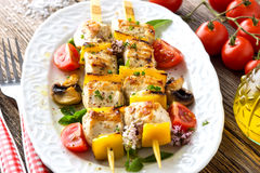 Griled Chicken skewers. On wooden background stock photo
