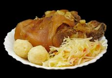 Griled pork knee. With cabbage and pastry Royalty Free Stock Photo