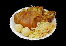 Griled pork knee. With cabbage and pastry Stock Photos